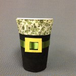 A boring plastic cup has been dressed up with fabric scraps and a paint chip just in time for ST. Patrick's Day.