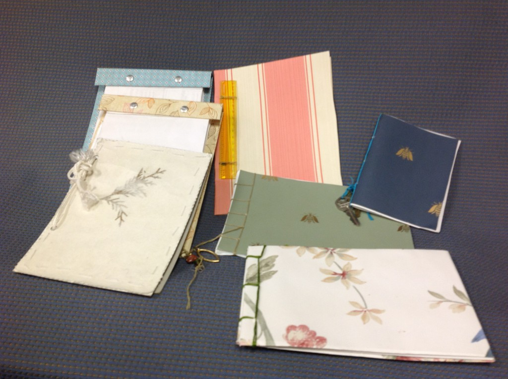 There's lots of ways to create notebooks and pads using scrap paper, board and wallpaper samples