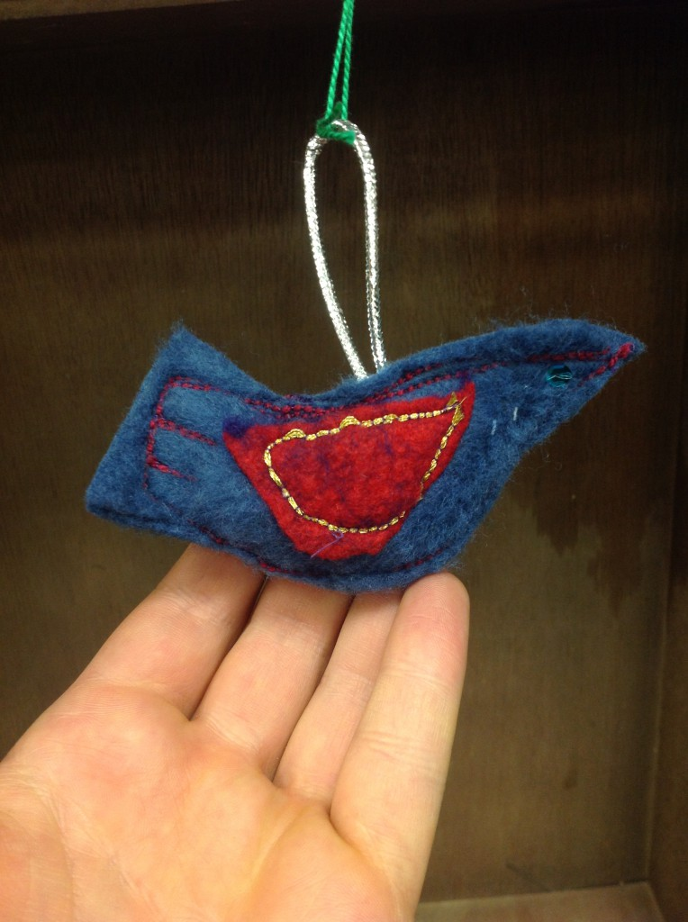 Holiday ornament made from felt and ribbon scraps